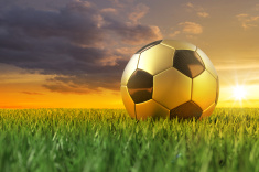 stock-photo-21312295-golden-soccerball-on-grass